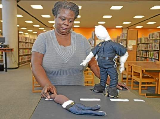 Long Beach Library Reverses Course on Police Shooting Artwork