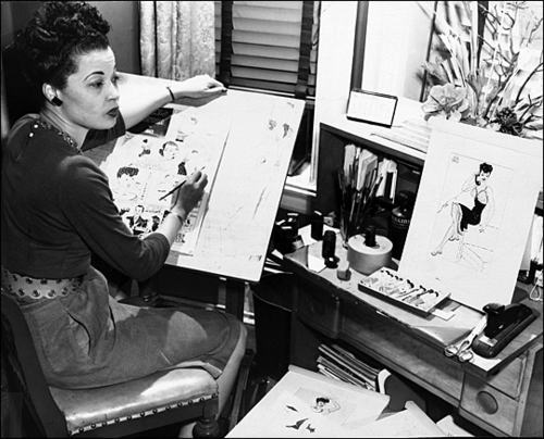 Jackie Ormes at her drawing table.