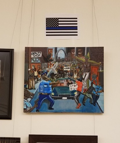 "Speech and counterspeech: an unknown party has hung a ""Blue Lives Matter"" flag above the painting."