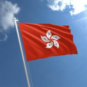 Hong Kong Flag waving in a bright blue sky