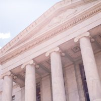 A dutch angle of the columns in front of a court house